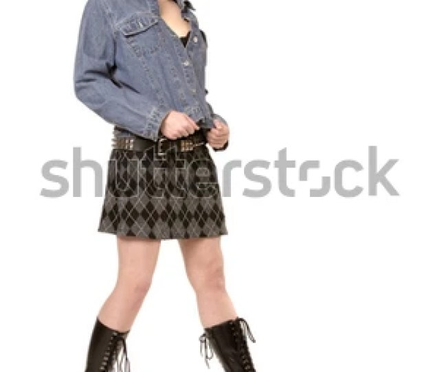 Sexy College Girl Posing In Skirt Jacket And Boots