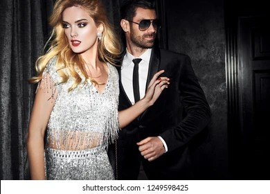 Sexy Elegant Couple Beautiful Woman Near The Man