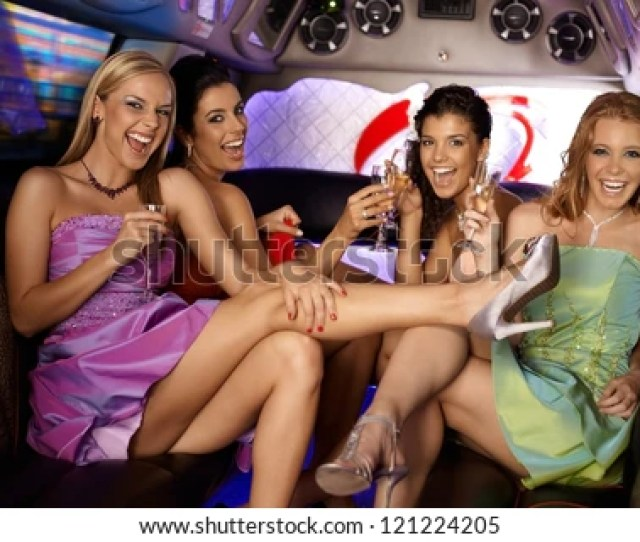 Sexy Girls Having Party In Limousine Smiling Drinking