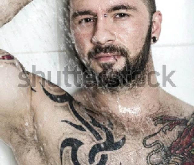 A Sexy Man With Tattoo On The Shower