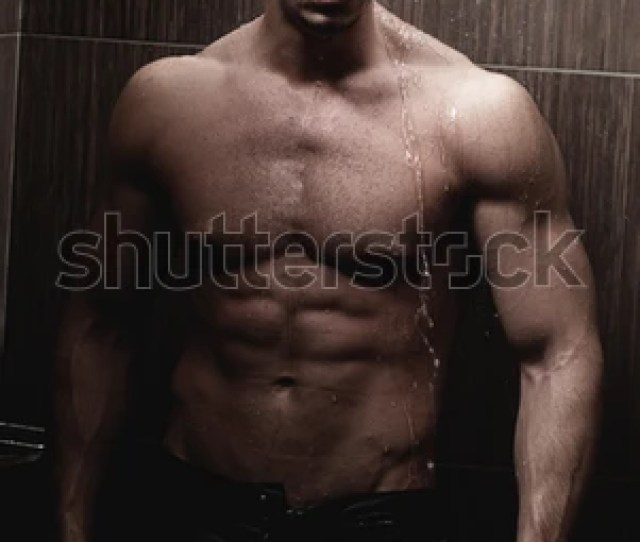 Sexy Young Muscle Man In A Shower Wearing Dark Underwear