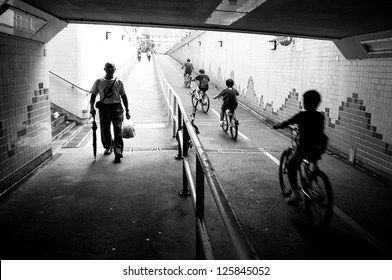 Street Photography Images  Stock Photos   Vectors   Shutterstock silhouette of cycling kids and father and an old walking man in the end of  tunnel