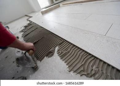https www shutterstock com image photo skilled worker installing ceramic wood effect 1685616289