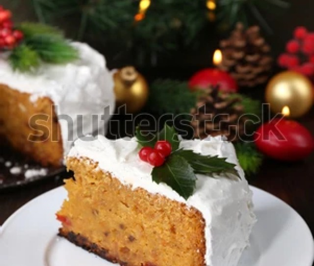Slice Of Cake Covered Cream With Christmas Decoration On Wooden Table Background