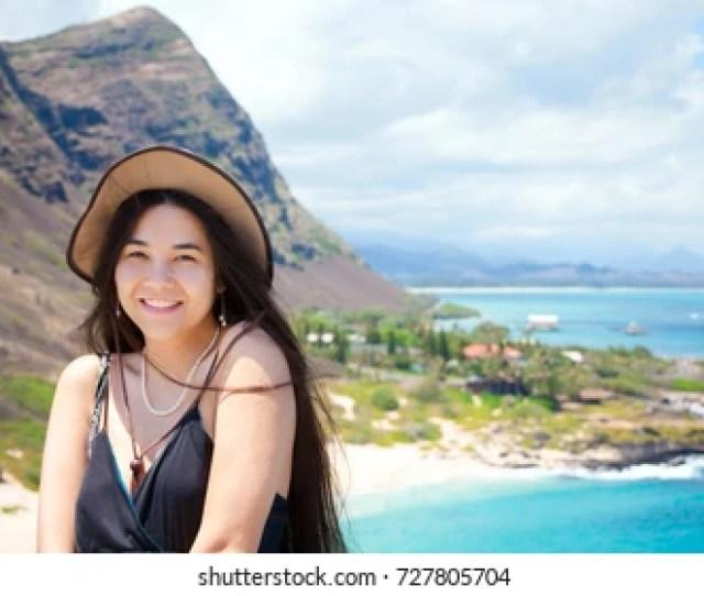 Smiling Biracial Teen Girl Or Young Woman Smiling At Camera With View Of Hawaiian