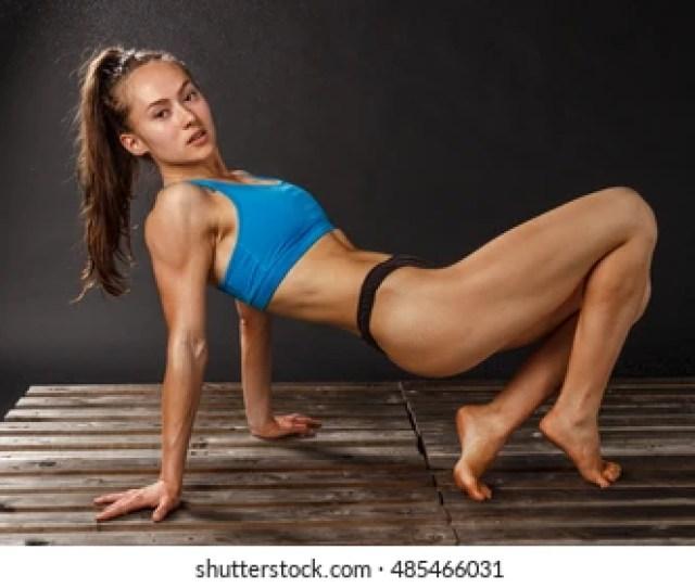 Sport Lady In Sexi Fitness Fluid Outfit Body Of Oil In Bikini