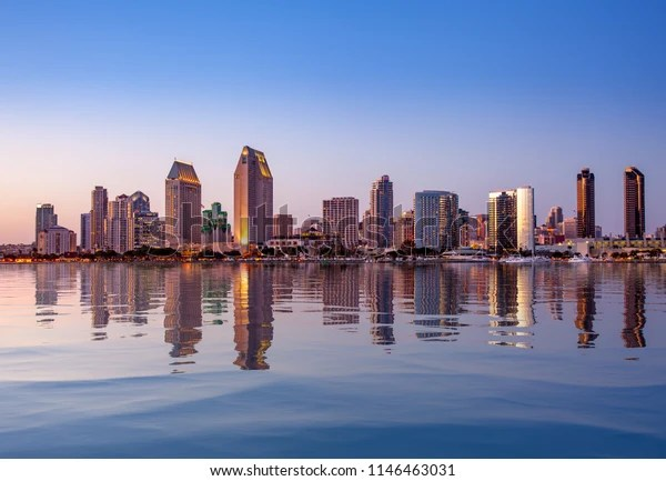 Sunset or dusk over the city of San Diego with an artificial water reflection