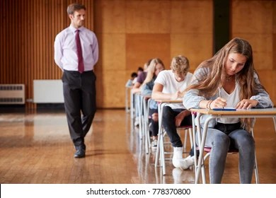 Invigilator Images  Stock Photos   Vectors   Shutterstock Teenage Students Sitting Examination With Teacher Invigilating