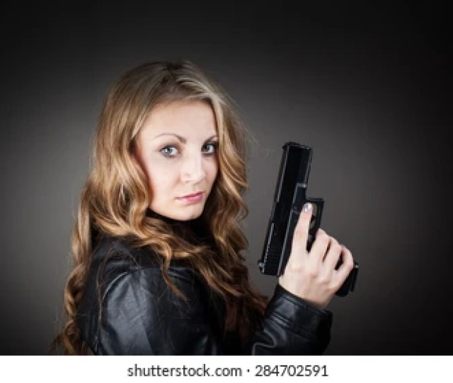 Top Secret Fbi Female Agent Holding Pistol Very Harsh Light For Underline The Atmosphere