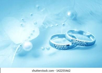 https www shutterstock com image photo wedding rings on blue background card 142255462