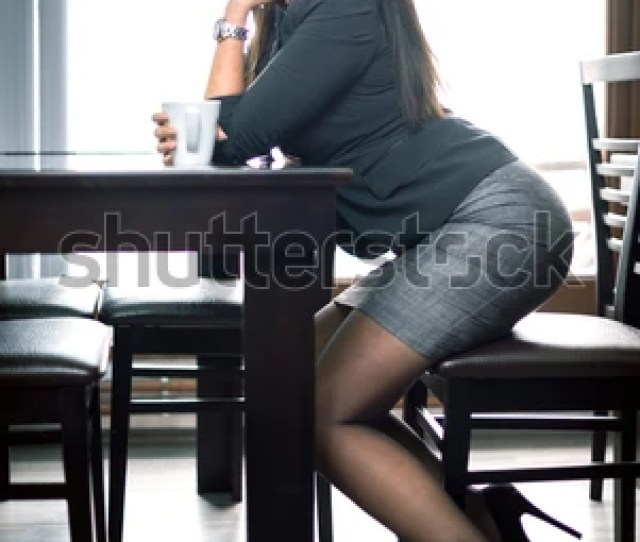 Young Attractive Sexy Business Woman Sitting At Table And Drinking Coffee Toned Image