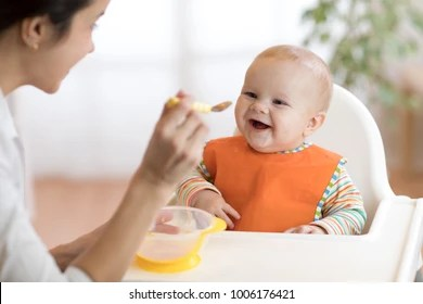 Image result for feeding a baby images