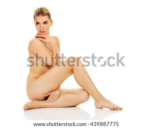 Young Naked Woman Sitting On The Floor