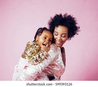 Young Pretty African American Mother With Little Cute Daughter Hugging Happy Smiling On Pink