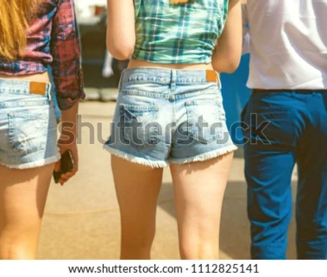 A Young Woman Is In Short Shorts Big Ass