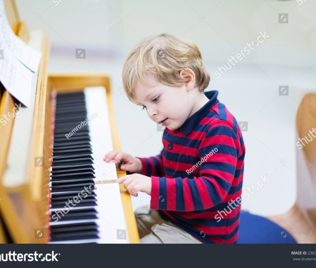 Two Years Old Funny Positive Toddler Child Playing Piano Early Music Education For Little Kids