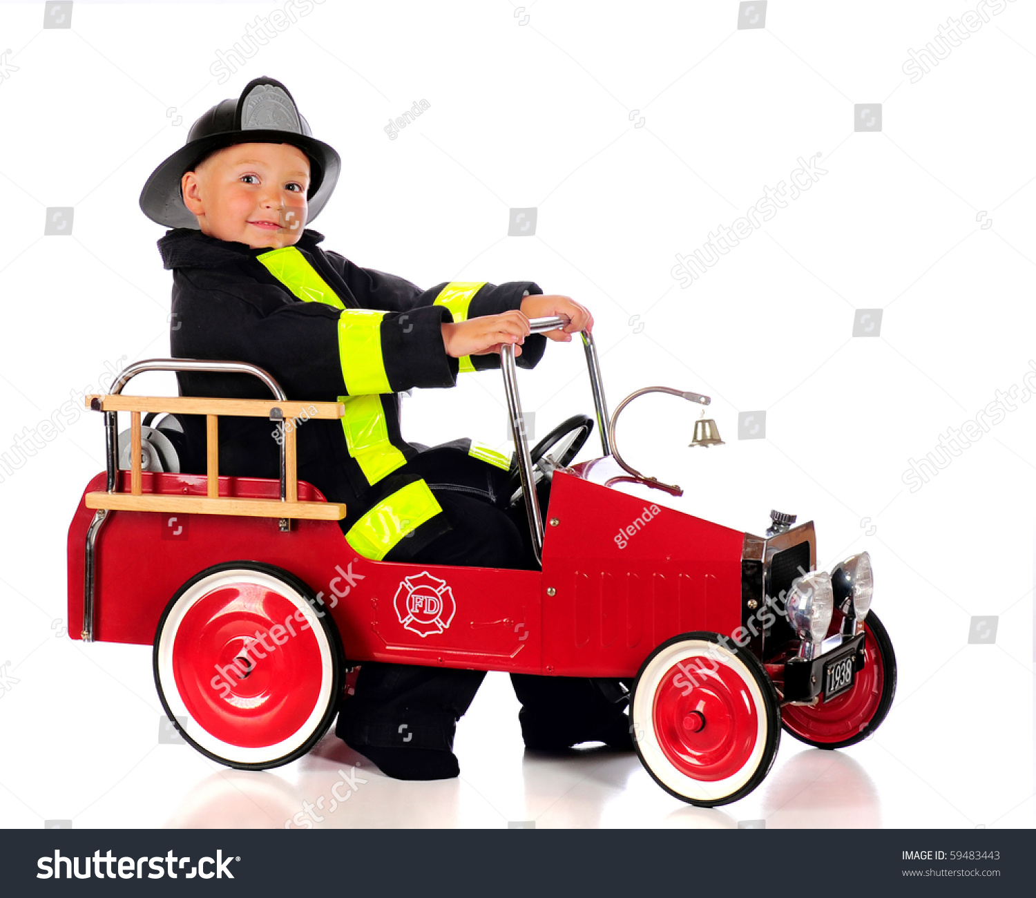An Adorable Preschool Fireman Dressed And Ready For A Fire