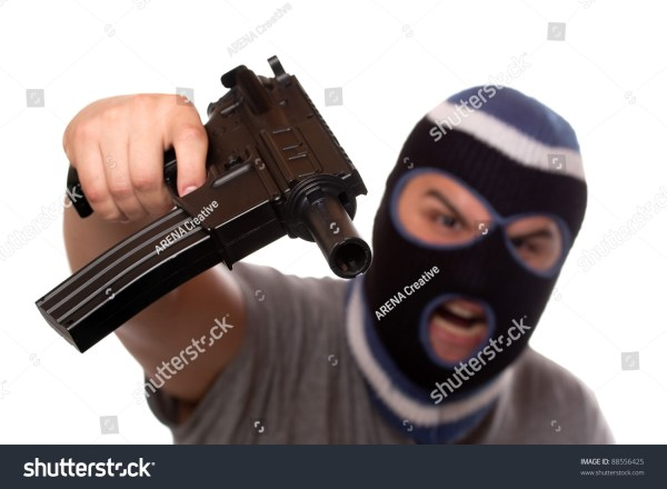 An Angry Looking Man Wearing A Ski Mask Pointis A Black ...