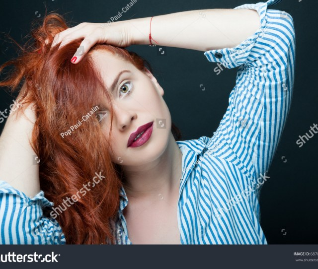 Beautiful Model Girl With Cute Face Playing With Her Hair On Dark Background