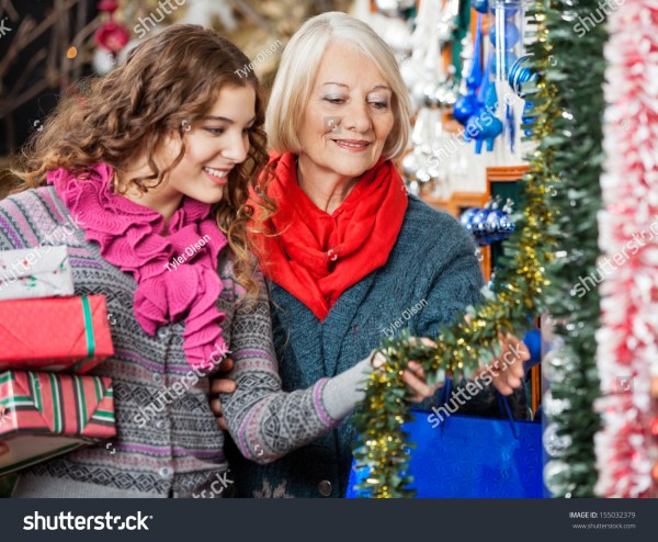 Beautiful Mother And Daughter Buying Christmas Decorations ...