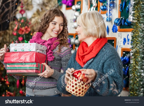 Beautiful Mother And Daughter With Bauble Basket And ...