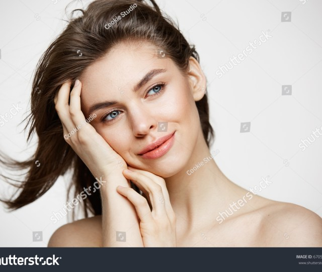 Beautiful Naked Young Girl With Perfect Clean Skin Smiling Touching Hair Over White Wall Facial