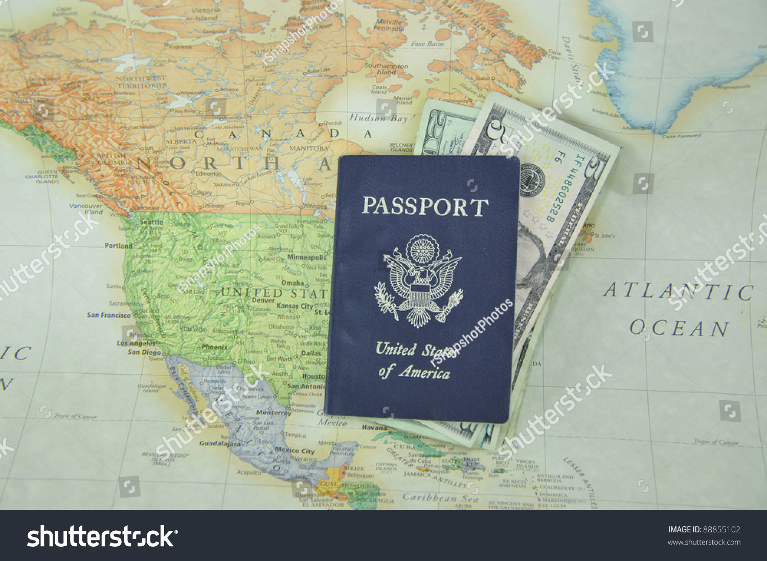 Blue American Passport Filled With U S Currency On Map