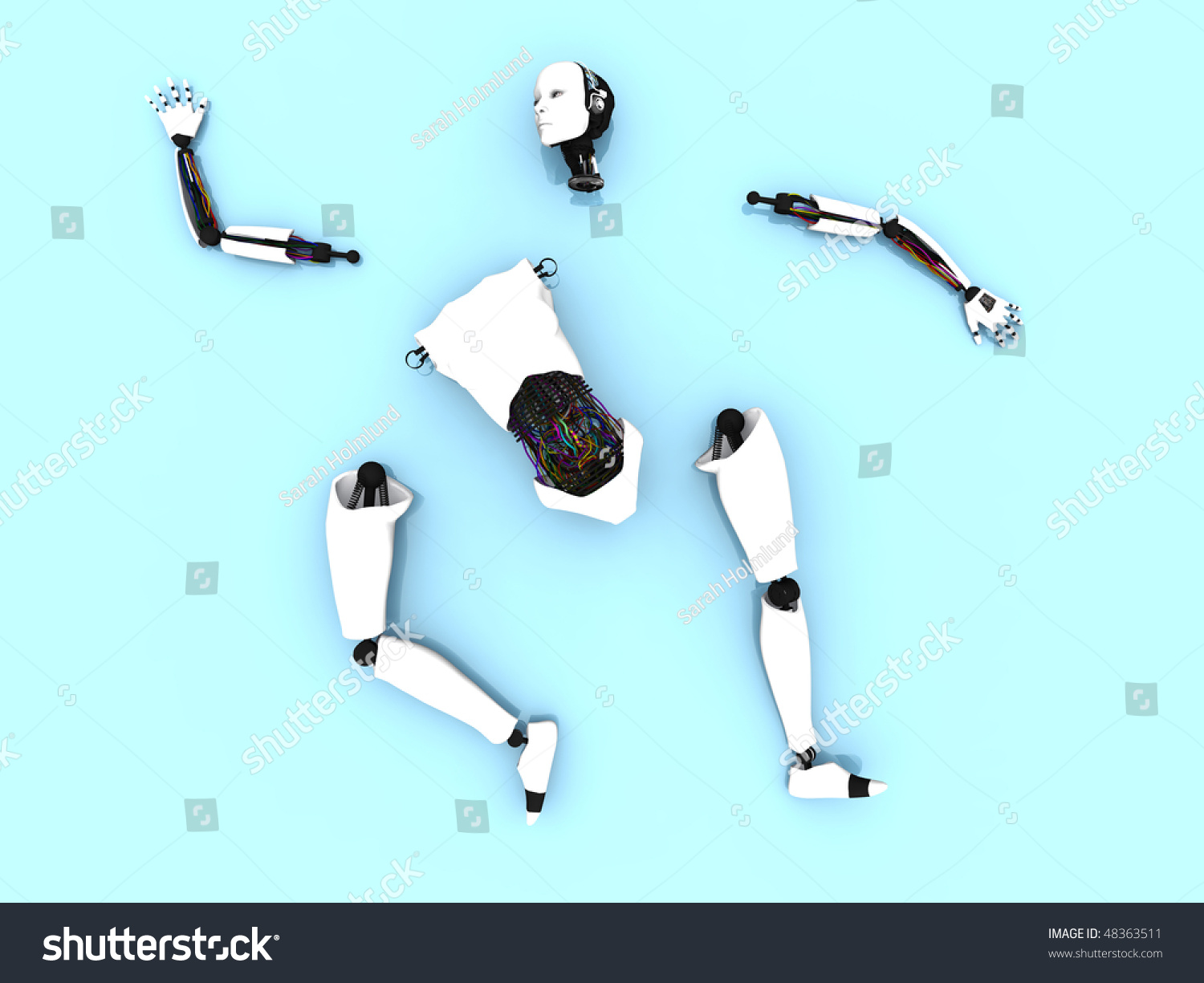 Body Parts Of A Female Robot Lying Spread Out On The Floor