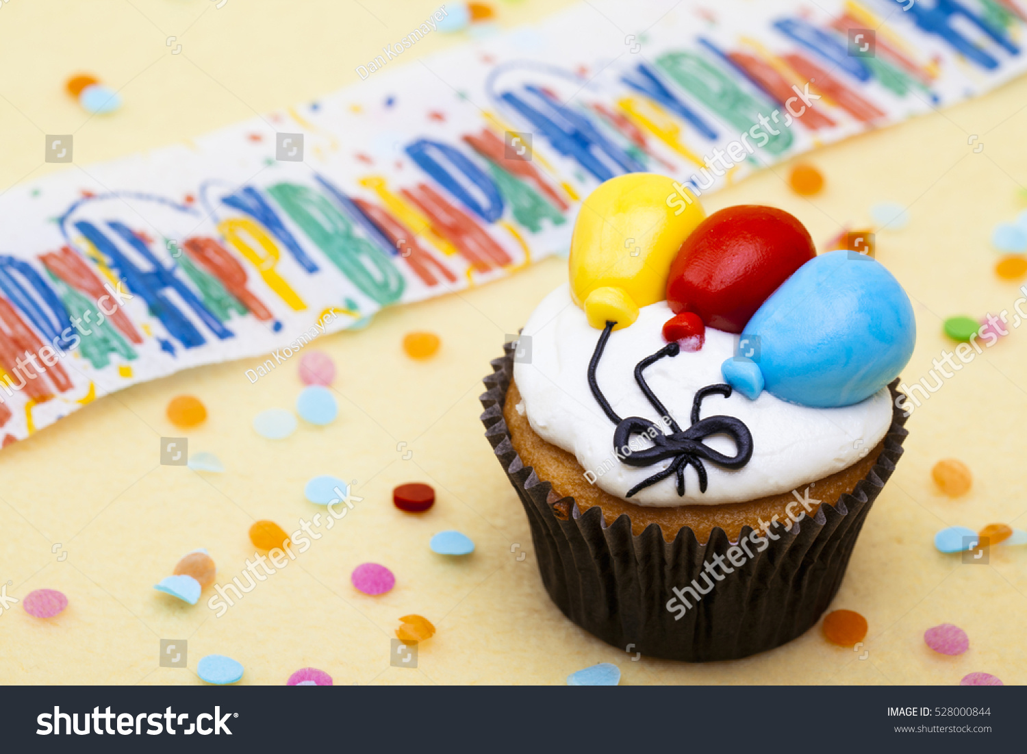 Celebration Cupcakes With Sprinkles And Balloons Isolated
