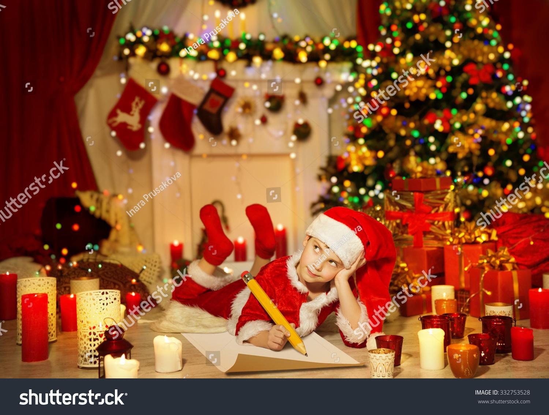 Christmas Kid Write Wish List Child In Santa Claus Hat