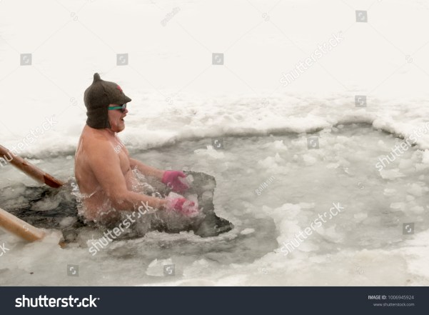 Ice swimming. Crazy elderly Russian man, swimming in the ice-hole as <a href=