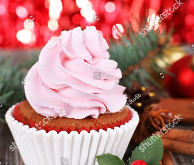 Cup Cake With Cream And Christmas Decoration On Wooden Table And Shine Brightly Background