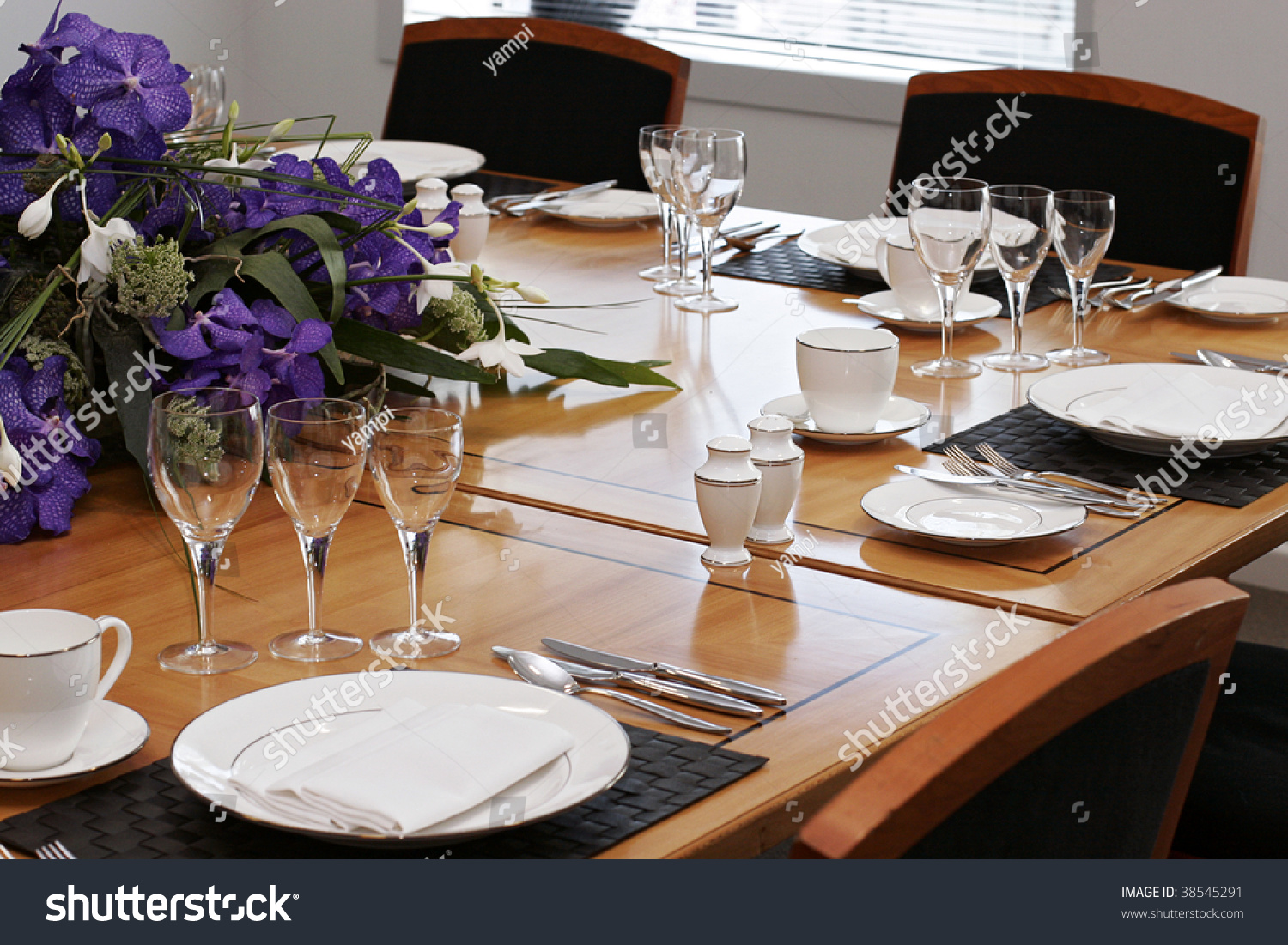 Formal Dining Table Set Up With Flowers Stock Photo