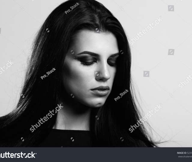Gorgeous Brunette With Gorgeous Makeup In Stylish Clothes Black And White Photo A Stern