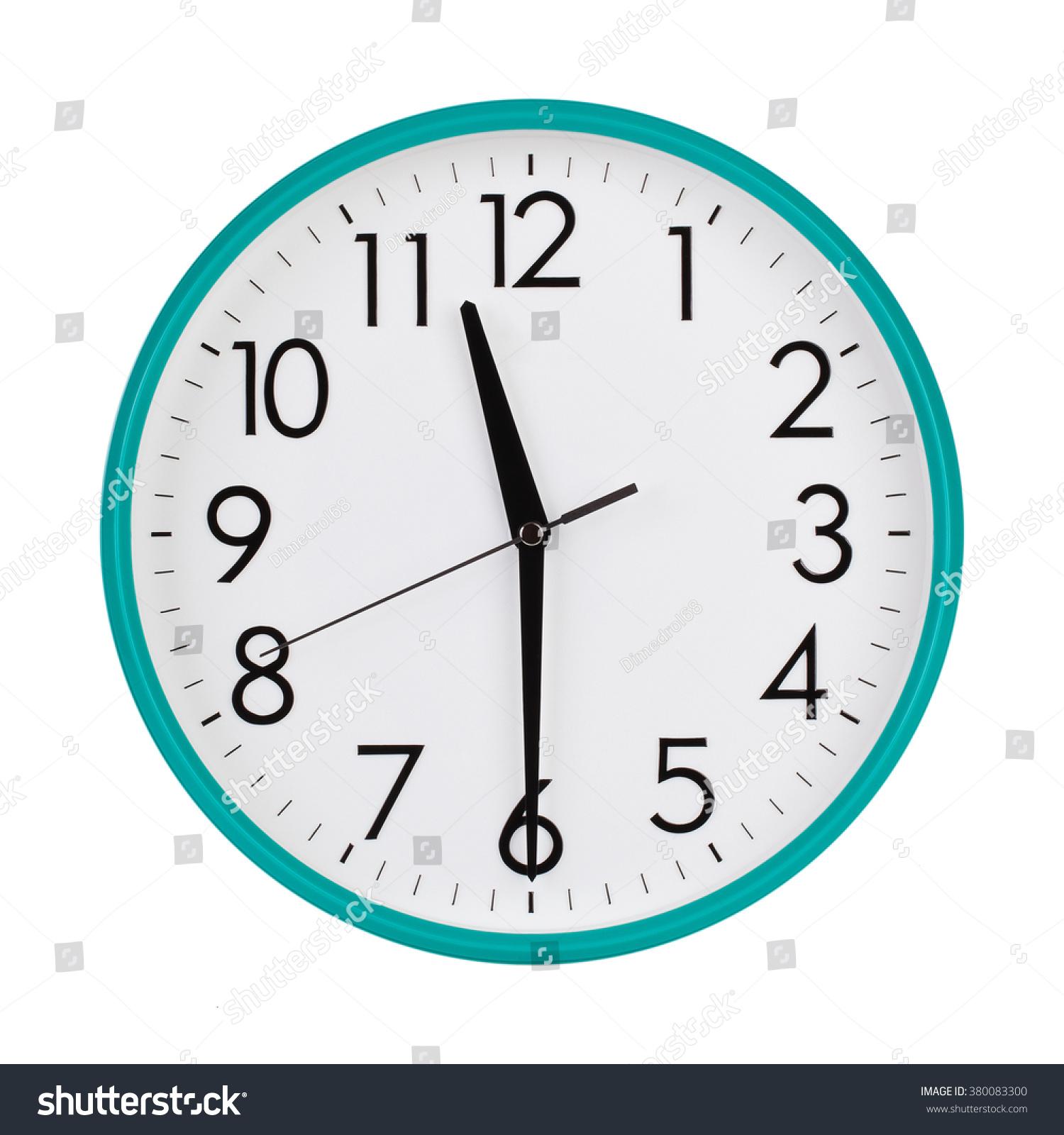 Half Past Eleven On Round Clock Stock Photo