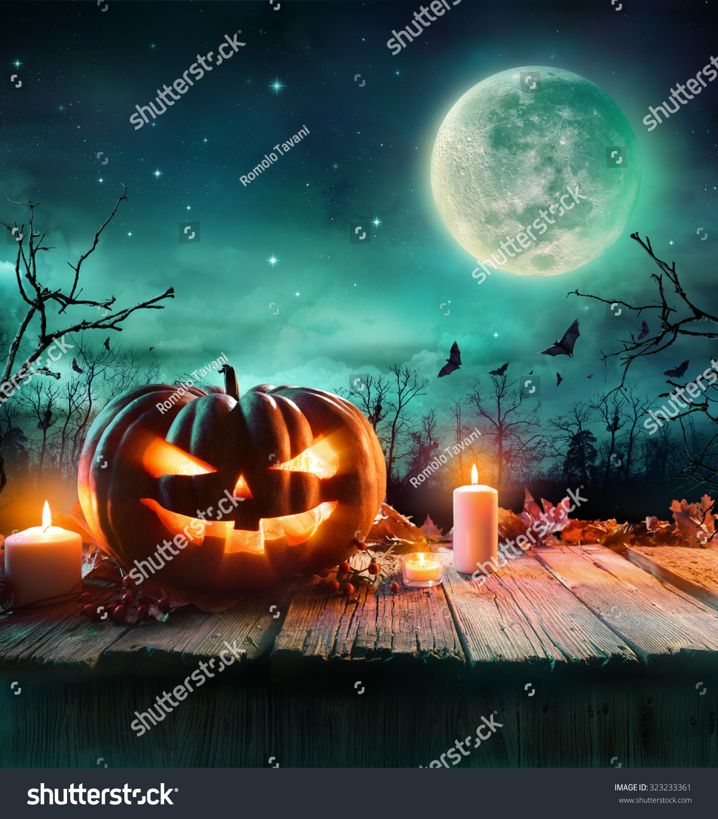 Halloween Pumpkin On Wooden Plank With Candles In A Spooky