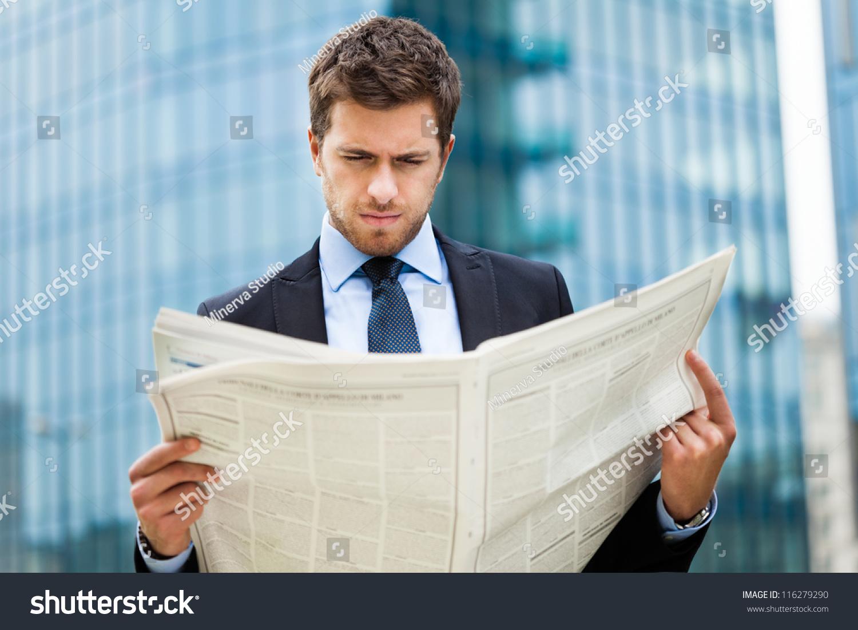 Handsome Man Reading Newspaper Stock Photo
