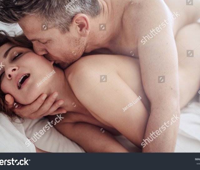 Intimate Lovers Caressing Making Love In Bed Romantic And Passionate Young Couple On Bed Having