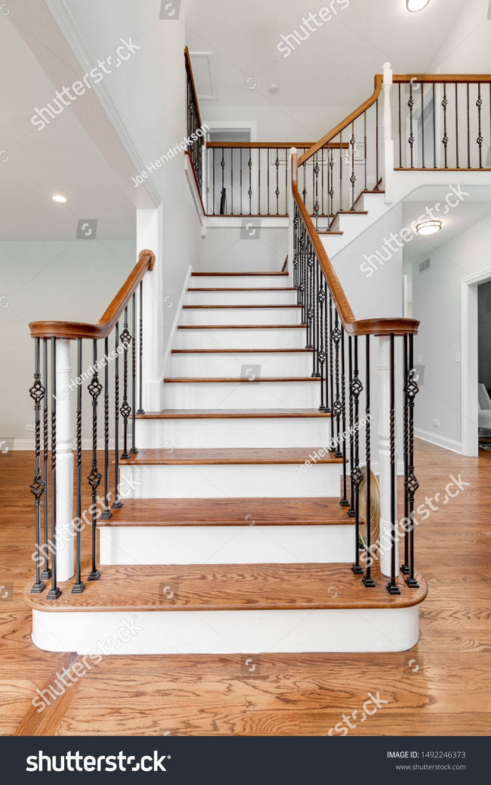 Looking Household Staircase Wrought Iron Railings Stock Photo | Wood And Rod Iron Railing | Wooden | Dark Stained | Wrought Iron | Pipe | Simple Modern