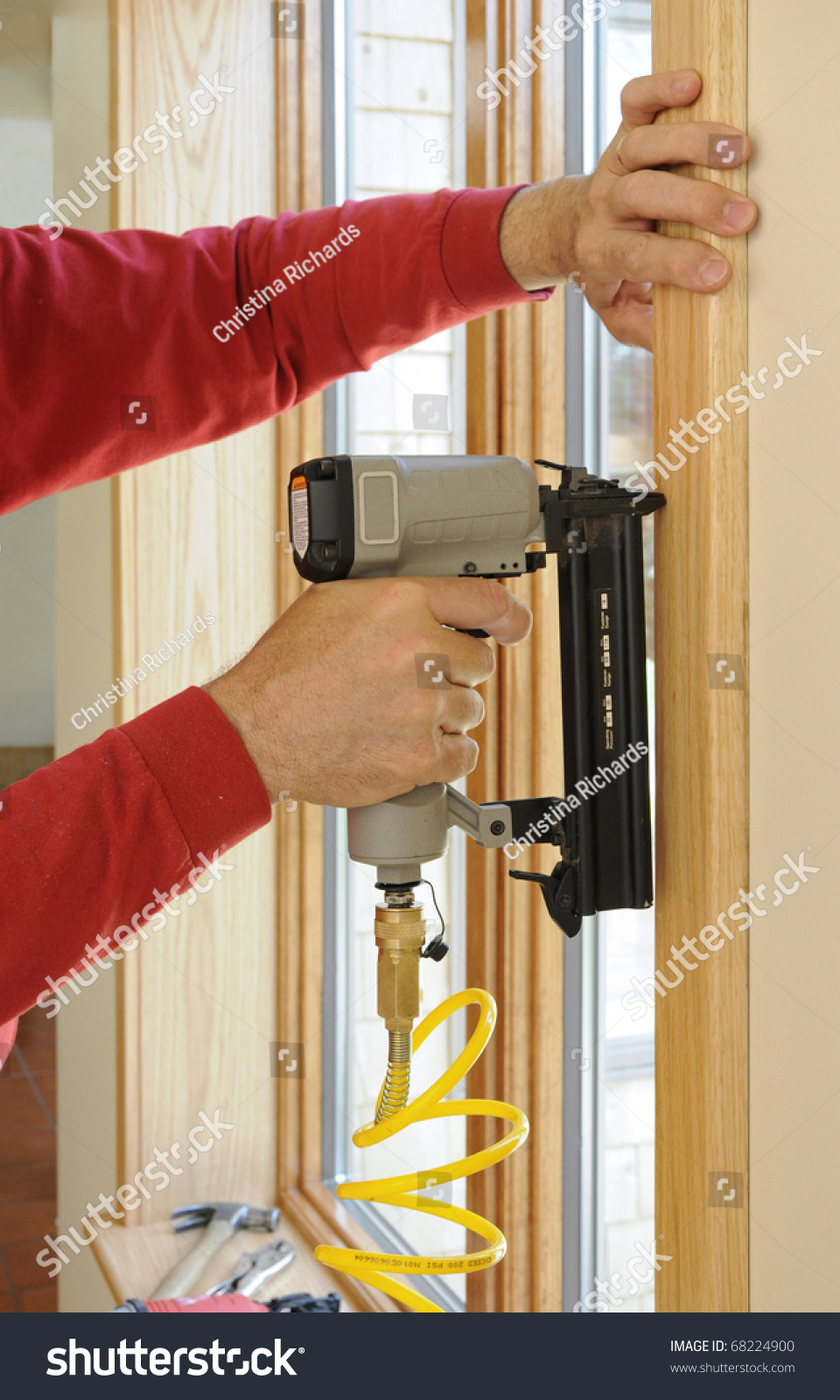 Nail Gun Being Used To Install Wood Trim Around Windows With Finishing Nails Stock Photo 68224900 : Shutterstock