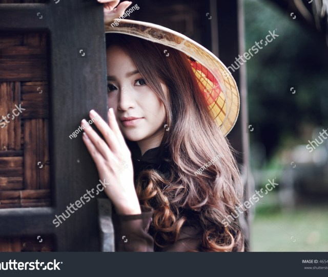 Portrait Beautiful Asian Girl With Vietnamese Dress Ao Dai And Old House In Farm