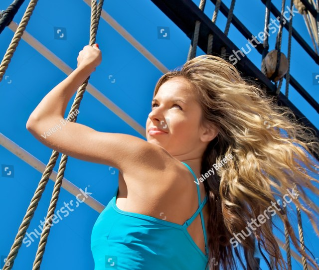 Portrait Of The Beautiful Young Girl On A Rope Ladder