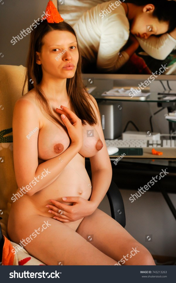 Pregnant nude girl sitting in front computer freelance student does homework