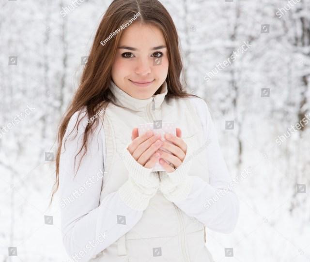 Teen Girl Enjoying Big Mug Of Hot Drink During Cold Day