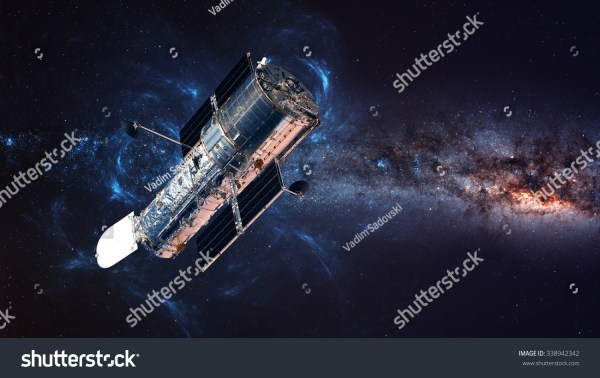 The Hubble Space Telescope In Orbit Above The Earth ...