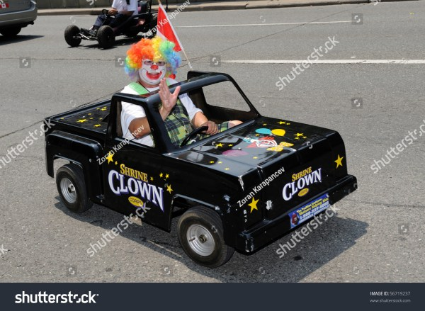 Toronto-July 6: Clown In Funny Little Black Car Takes Part ...