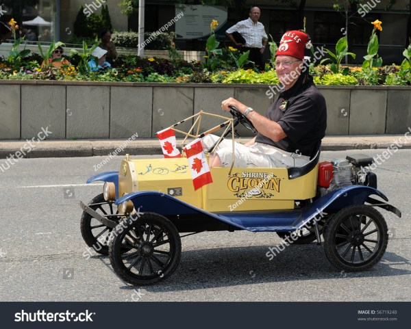 Toronto-July 6: Shriner On Funny Little Yelow Car Takes ...
