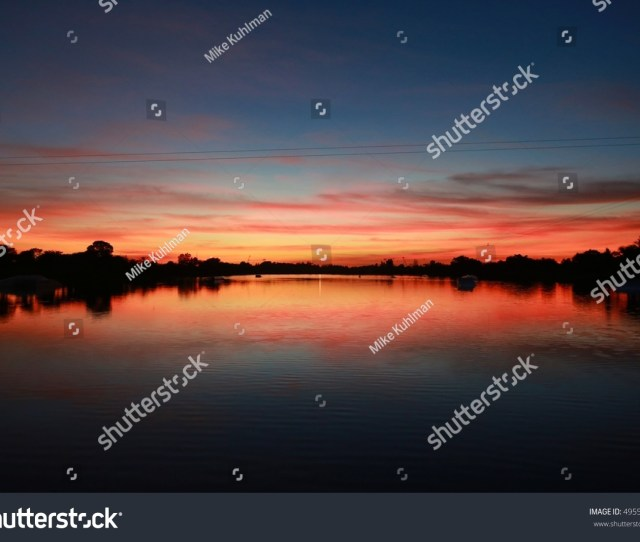 Twilight On The Ski Rixen Lake With Reddish Orange Clouds Amidst Blue Sky At Quiet Waters