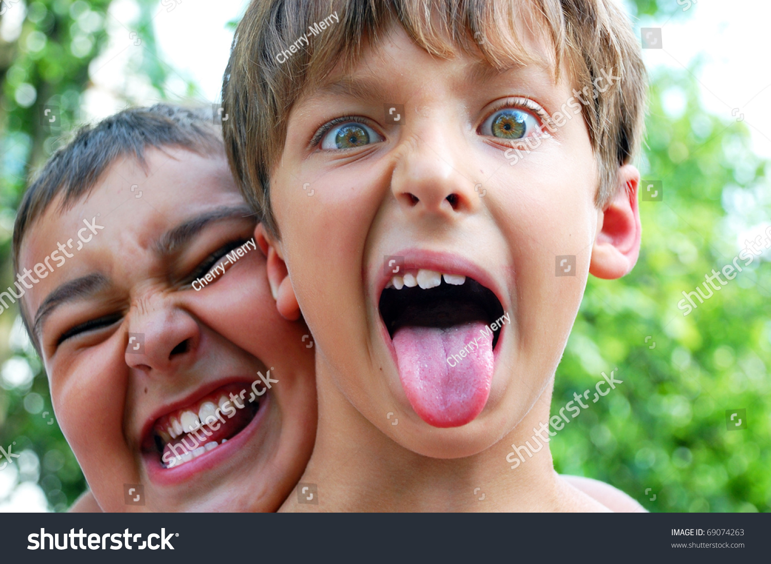 Two Cute Boys Making Crazy Faces Stock Photo