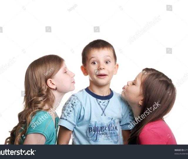 Two Little Girls Kissing Surprised Little Boy